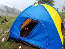 A tent on forest tracking royalty free stock photography