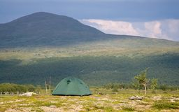 Tent in Front of a Big Mountain Royalty Free Stock Images