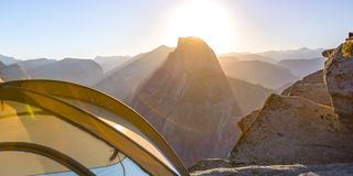 Tent in Glacier Point with Half Dome at sunrise stock images