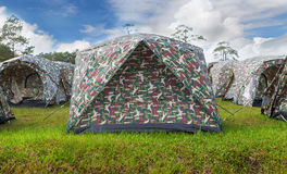 Tent on grass in mountain camping site Royalty Free Stock Photography