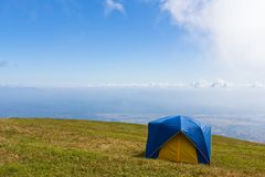 Tent on a grass under  blue sky Royalty Free Stock Photos