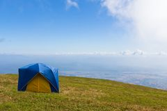 Tent on a grass under  blue sky Stock Photography