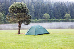Tent on green grass lawn Stock Image