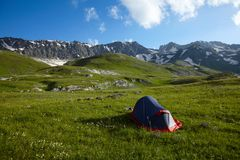 Tent on green grass in the mountains Royalty Free Stock Image