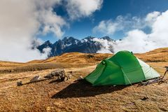 Tent green spread out on the pass Goulet. Georgia, Svaneti. Caucasus Mountains. royalty free stock image