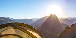 Tent and Half Dome in Yosemite with lens flare royalty free stock image