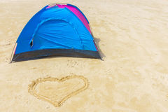 Tent and heart on the beach Royalty Free Stock Photo