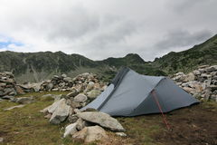 Tent in the heart of mountains Stock Photography