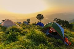 Tents and Camping on the High Mountain. stock photos