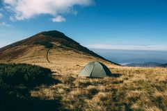 Tent high in mountains. Carpathian. Top on background stock photo