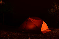 Tent hiker in night. Near with fire Stock Image