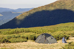 Tent in the hikers camp in Carpathian mountains Royalty Free Stock Photo