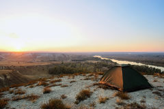 Tent on the hill and river at sunset. Royalty Free Stock Photos