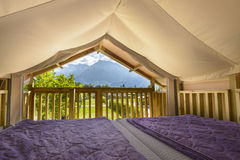 Tent-House Overlooking in mountains Royalty Free Stock Photography