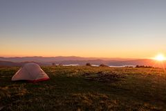 Tent on huckleberry knob overlooking appalachian mountains. At sunrise during early autumn royalty free stock image