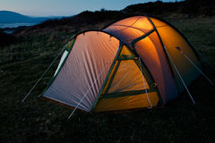 Tent illuminated at night Stock Photos