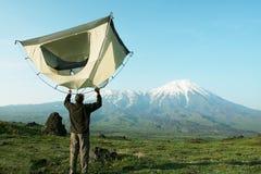 Tent in Kamchatka. Hiker for tent on Kamchatka stock image