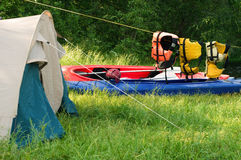 Tent and kayak. Tent set up for camping by a river Stock Images