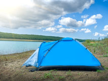 Tent by the lake Stock Image