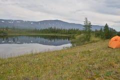 Tent on the lake shore. Stock Photo