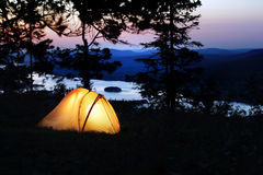 A tent lit up at dusk Stock Photos