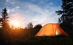 A tent lit up at dusk Stock Photo