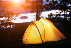 Tent lit up at dusk Stock Images