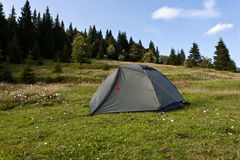 Tent on the meadow. Royalty Free Stock Photo