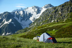 Tent on meadow in the high mountains Royalty Free Stock Images