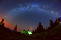 Tent in the meadow at night, the starry sky and the Milky Way Royalty Free Stock Photography