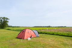 Tent in meadows. Single tent in the middle of the meadows stock photo