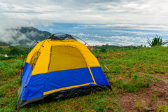 Tent and the mist. The blue tent on the mountain that can see the mist view stock image