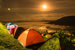Tent  with  mist under the moonlight Stock Photos