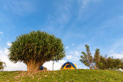 Tent on mountain in bule sky Stock Photo