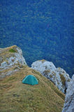 Tent on mountain cliff edge in the evening Royalty Free Stock Photo