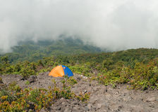 Tent on the mountain in fog and clouds. Volcano Mount Merapi. Stock Photography