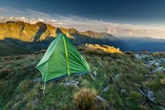Tent on the mountain summit Stock Photos