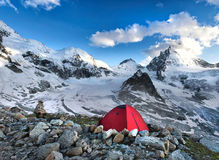 Tent. In mountain wit high peaks in mountains Royalty Free Stock Image