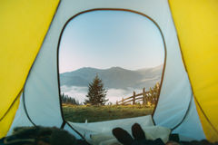 Tent in mountains. Dawn in mountains Stock Image