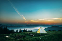 Tent in mountains. Dawn in mountains Stock Photos