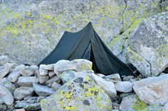 Tent in mountains. Royalty Free Stock Photography