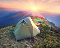 Tent in the mountains Stock Photo