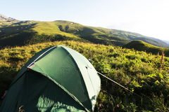 Tent in mountains Stock Photo