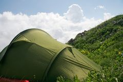 Tent in mountains after rain Stock Photography