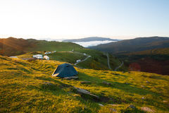 Tent in the mountains. Sunrise, campsite royalty free stock image