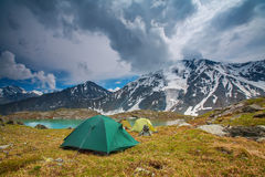 Tent near mountain lake Royalty Free Stock Images