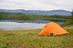 Tent near the pond. Stock Images