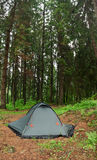 Tent nestled in early morning wilderness campsite. A tent in a wilderness area, meadow, trees, 16MPix - XXL size. This panoramic landscape is an very high Royalty Free Stock Image