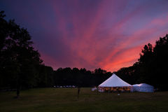 Tent at night. An event tent at night with a nice sunset during a wedding Royalty Free Stock Image