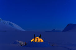 Tent at night. Tent in the snow in Arctic Sweden, Lapland Royalty Free Stock Photos